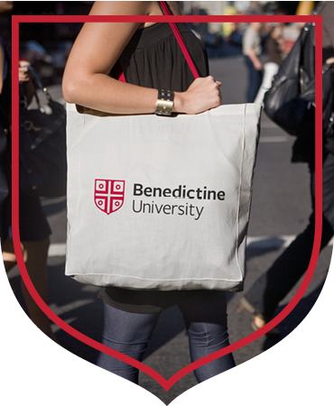 Student with Benedictine University tote bag framed by BenU banner