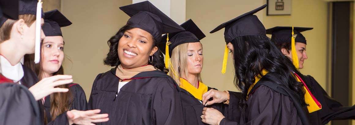 Students interact during the first-ever Benedictine University at Mesa Commencement Convocation held Saturday, May 16.