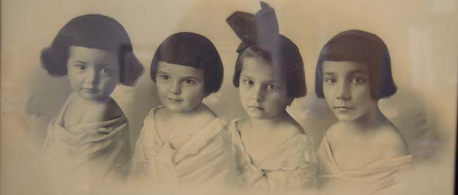 An undated black and white oil painting of Mikula's mother and her aunts as children.