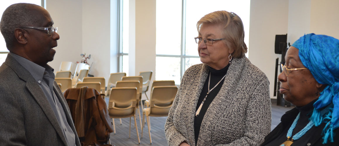 James Garrett, Ph.D., J.D., speaks with Susan Mikula, Ph.D., acting dean of the College of Liberal Arts, and Fannie Rushing, Ph.D., professor of History, during a talk about race relations at Benedictine University in 2015.
