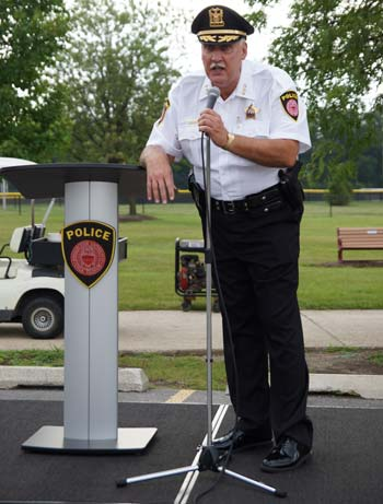 BenU Police Chief Michael Salatino speaks during a National Night Out on Benedictine's Lisle campus.