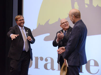 Michael S. Brophy, Ph.D., M.F.A., president of Benedictine University, speaks with NASA scientist James Hansen, Ph.D., and WGN-TV's chief meteorologist Tom Skilling during a discussion on climate change.