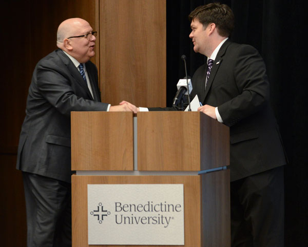 Phil Hardy, Ph.D., director of the Center for Civic Leadership at Benedictine University, greets WGN-TV chief meteorologist Tom Skilling during a climate change discussion on campus.