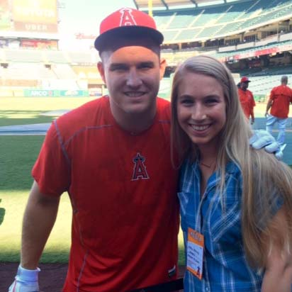 Molly Morley pictured with Michael Trout, five-time All-Star center fielder for the Los Angeles Angels of Anaheim and 2014 American League MVP.