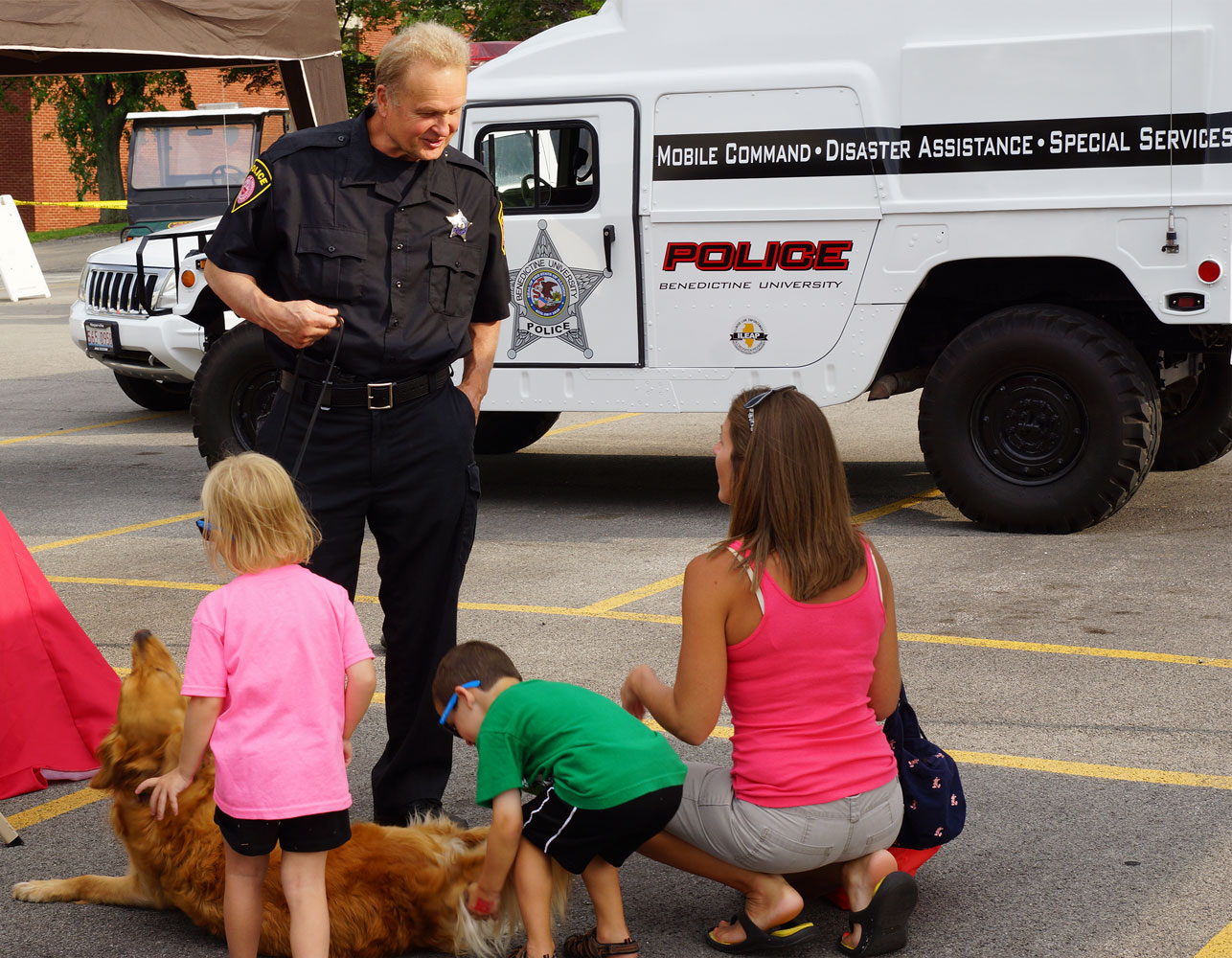 Retired BenU Police K-9 officers interact with the public during a National Night Out event at Benedictine's Lisle campus.