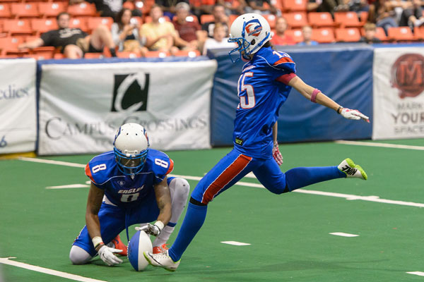 Julie Harshbarger, C08, kicks a field goal while playing professional indoor football for the Chicago Eagles. (Photo Credit: BriAmo Photography)
