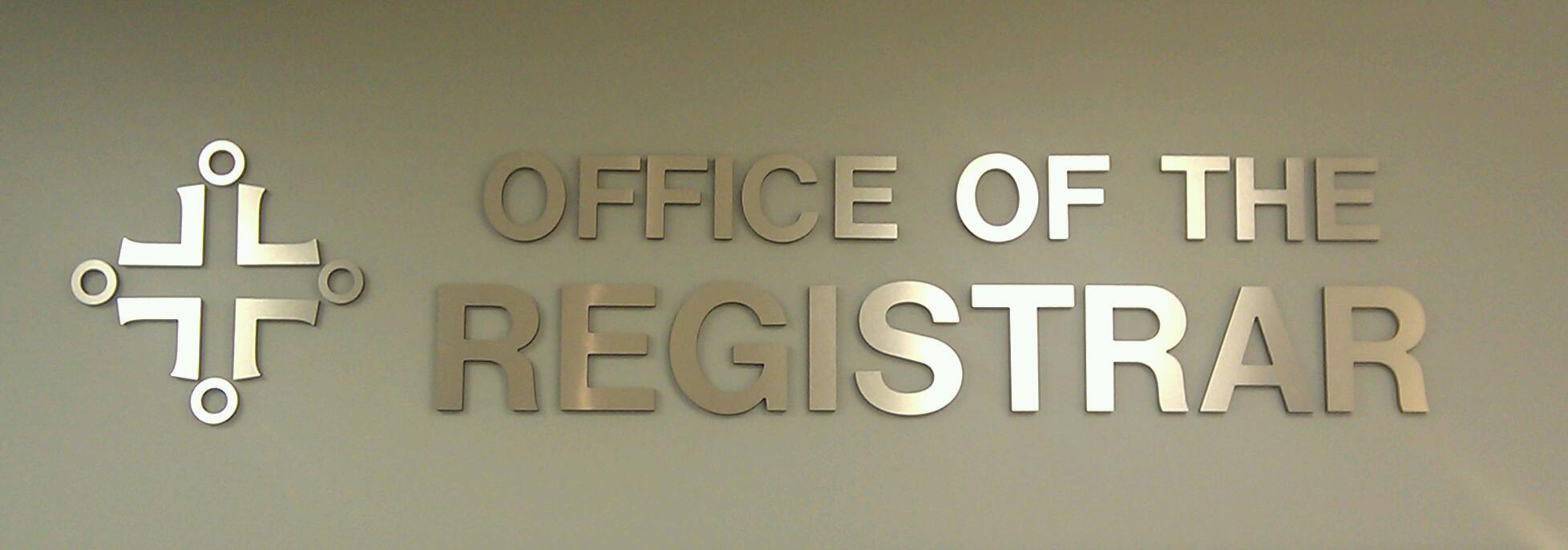 pictures of the office. sign inside of the office registrar pictures